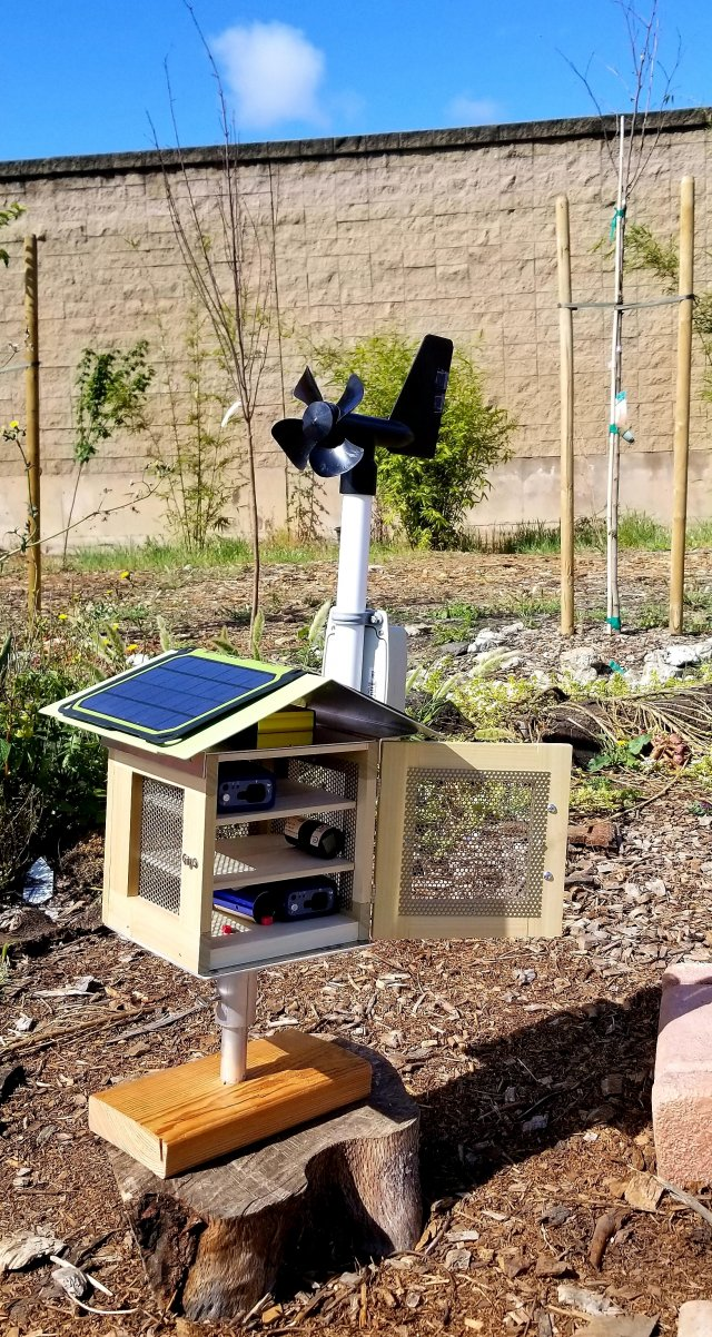 An educational air quality monitoring device designed to look like a birdhouse and powered by solar panels.