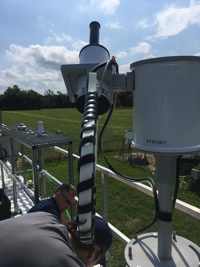 EPA scientists David Williams and Jim Szykman set up a ground-based Pandora spectrometer for satellite validation on the New Jersey Department of Environmental Protection air quality monitoring site at Rutgers University in New Brunswick, NJ.