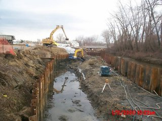 [January 11, 2000] Excavation of sediments with small excavator, removal of sediments with large excavator located on top of bank.
