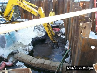[January 28, 2000] Cell C - Initial attempt to remove DNAPL (or heavy oil) by excavation down to four feet.