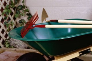 Wheelbarrow symbolizes the importance of including O&M in planning.