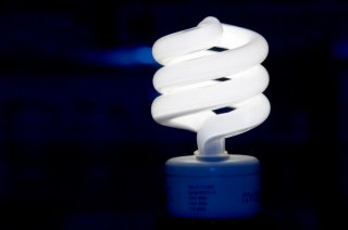 this is a picture of a spiral shaped compact flourescent lightbulb often known as a CFL