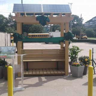EPA's latest Village Green bench is wrapped in ribbon.