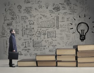 Stock photo schematic of an idea - a man approaching a lightbulb; also a link to a page detailing ongoing CMAQ research and development