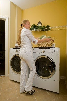 Image of a woman in a laundry room.