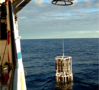 The Rosette water sampler being lowered into Lake Superior to collect raw water samples at different depths for chemical and biological analyses