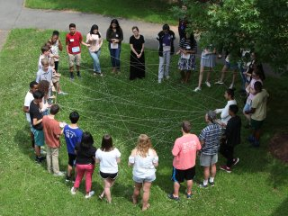 Students participate in a lesson that explores connections between ecosystems and human health.
