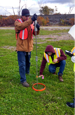 The field crew performs a penetration test using a single mass penetrometer.  Photo credit: Tetra Tech.