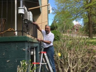 R. Subramanian repairing a RAMP at an Allegheny County Clean Air Now member's house near Neville Island.